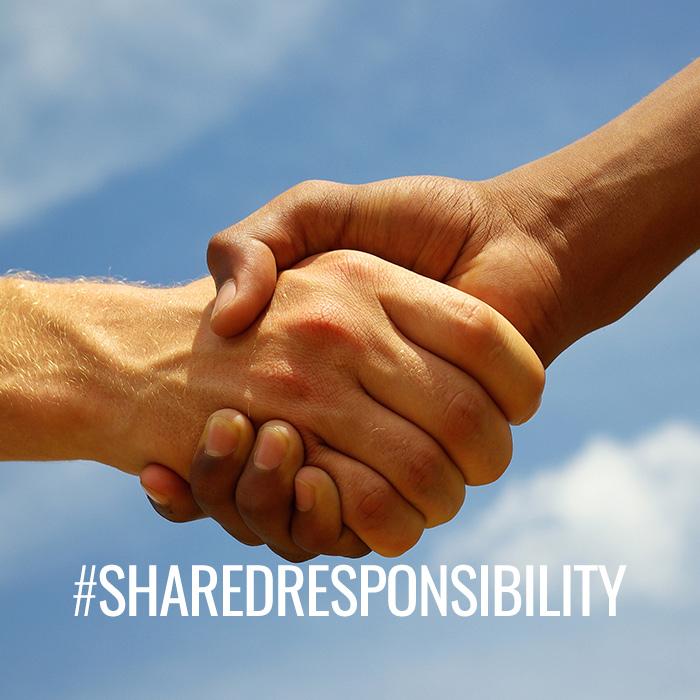 #SharedResponsibility shaking hands
